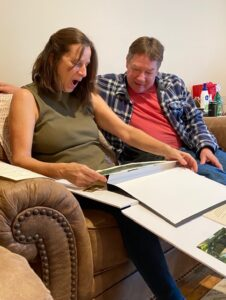 Recipients unwrap their house portrait gift